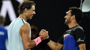 Rafael Nadal se despide de Víctor Estrella tras su retirada del tenis